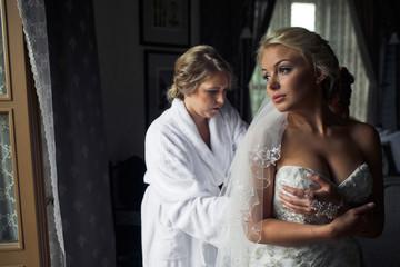 Sensual blonde bride in the hotel room
