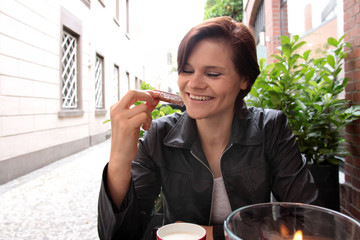 woman taking a cookie