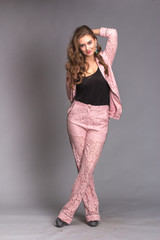 Portrait of a happy woman pink suit