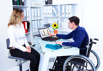 disabled business man and his female colleague
