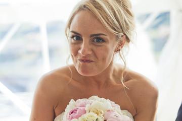 funny bride smiling at the camera