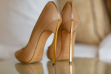 Luxury bridal shoes on the high heels