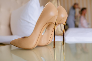 Beige bridal shoes on the high heels