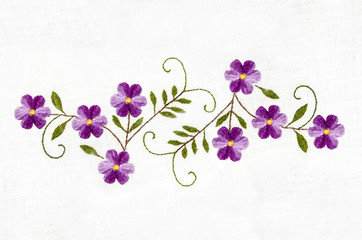 Embroidered satin stitch,melange thread purple flowers with leaves on cotton cloth