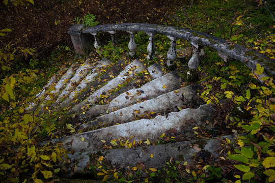 old stone staircase with a handrail in the estate
