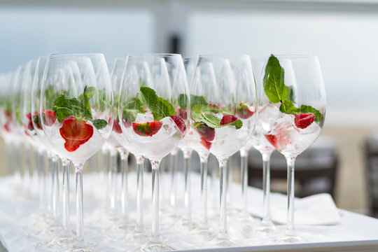 Cocktail glasses with strawberries and ice at a ceremonie