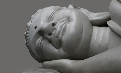 Sleeping Buddha on a black background.