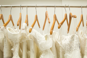 Bride dresses hanging in the dress room