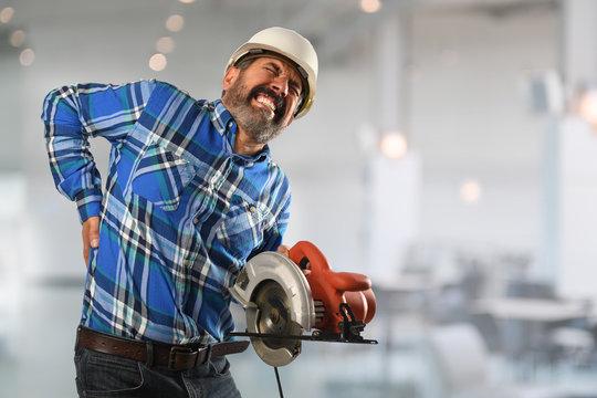 Hispanic Worker Suffering Back Injury