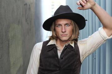 Vintage 1900 cowboy. Young man.