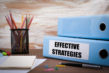 Effective Strategies, Office Binder on Wooden Desk. On the table