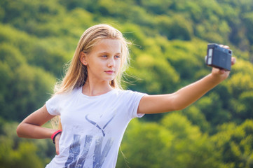 Happy little girl making a selfie