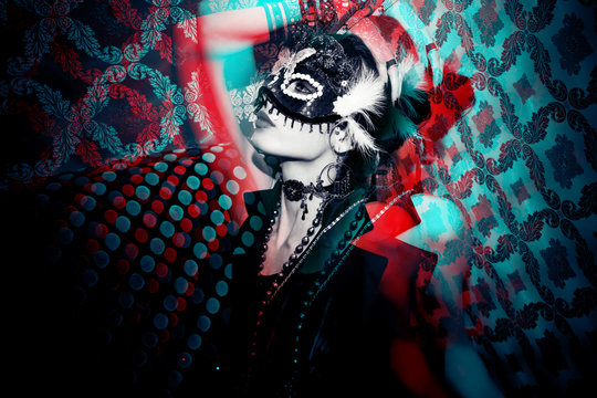 woman with mask in night club