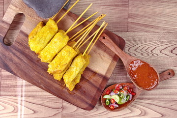 Pork satay served with Thai cucumber chili sauce and nut sauce are home made in big size.