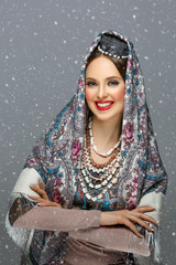 Beautiful russian girl in traditional clothes