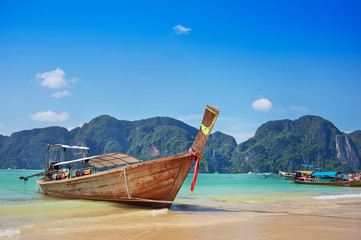 Longtail boat in the beautiful sea over clear sky