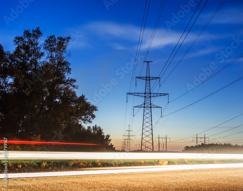 """Electricity transmission power lines at sunset High ..."