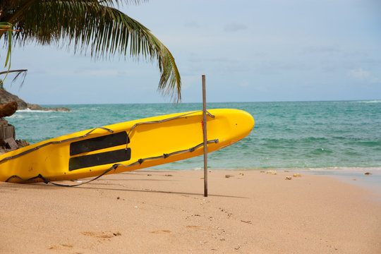 Yellow surf rescue board on the beach