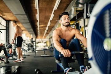 Determined bodybuilder rowing