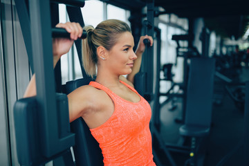 Beautiful woman doing chest exercises