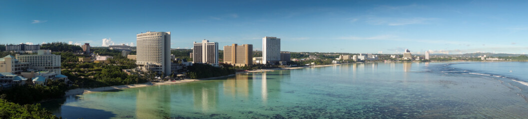 beautiful sunset beach and buildings in guam