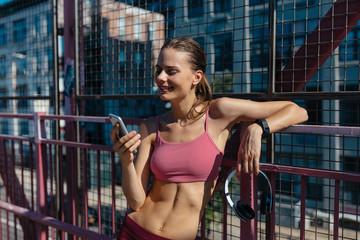 Young Female Runner Listening Music with Headphone . Williamsburg Bridge Brooklyn NYC