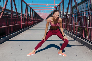 Young Woman Taking A Break after a Run . Williamsburg Bridge Brooklyn NYC