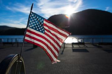American flag waving in lake background