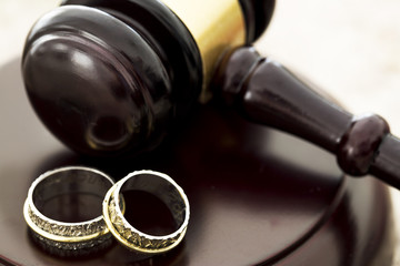 Family law concept, gavel and rings