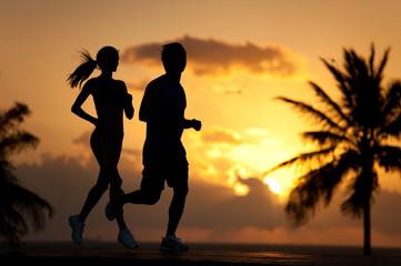 Man and Woman Running at Sunrise Sunset Silhouette