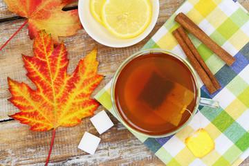 Tea, autumn leaf, lemon and cinnamon sticks
