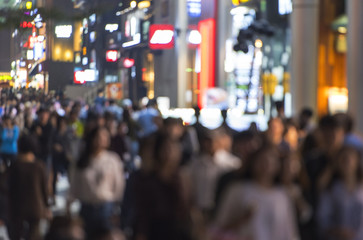 Crowd of people moving on the night street in Seoul - south Korea -  blurred abstract image