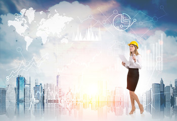 Woman in yellow hard hat and diagrams against cityscape