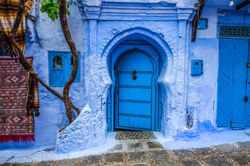 Garden Poster Morocco Traditional blue door on an old street inside Medina of Chefchaouen, Morocco