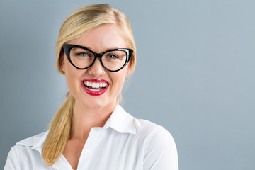 Young blonde businesswoman in black glasses