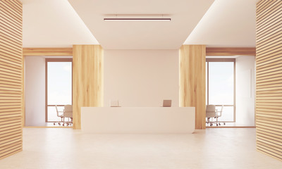 Close up of sunlit reception desk in light wood corridor