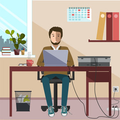 Office worker sitting in front of computer.
