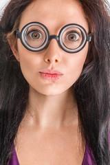 Woman portrait in crazy glasses