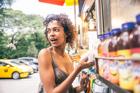 Woman buys hotdog in New York