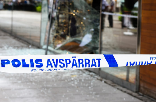 Sodertalje, Sweden - 4 August 2016: Crime scene investigation police do not cross boundary tape investigating police team, a store has been burglaries