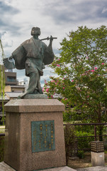Fotobehang Wenen Kyoto, Japan - September 16, 2016: Izumo No Okuni statue at crossing of river and Gion neighborhood. She is the founder of the Kabuki dance at the start of 17th century.