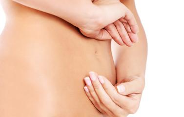 Hands on slim female belly