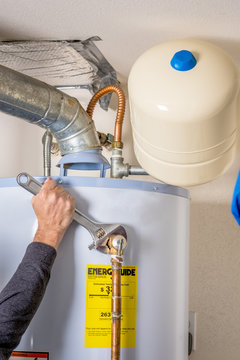 Hot water heater maintenance with a wrench