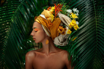 young woman in turban with flowers