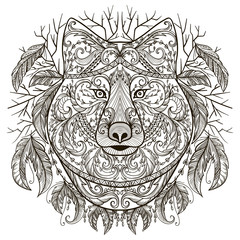 Wolf head with tribal aztec ornament in boho style. Tattoo art. Vintage hand drawn vector illustration.