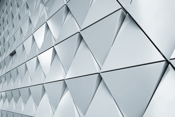 Abstract 3d illustration of modern aluminum ventilated triangles on facade