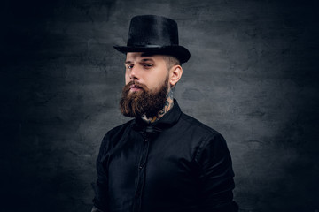 Bearded male with tattoo on his neck and top hat cylinder on hea
