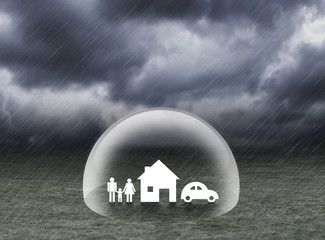 shield covering home,car and family under rain, insurance concept