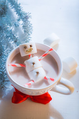 Funny snowman made of marshmallows for xmas