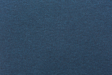 Texture of dark blue color paper.